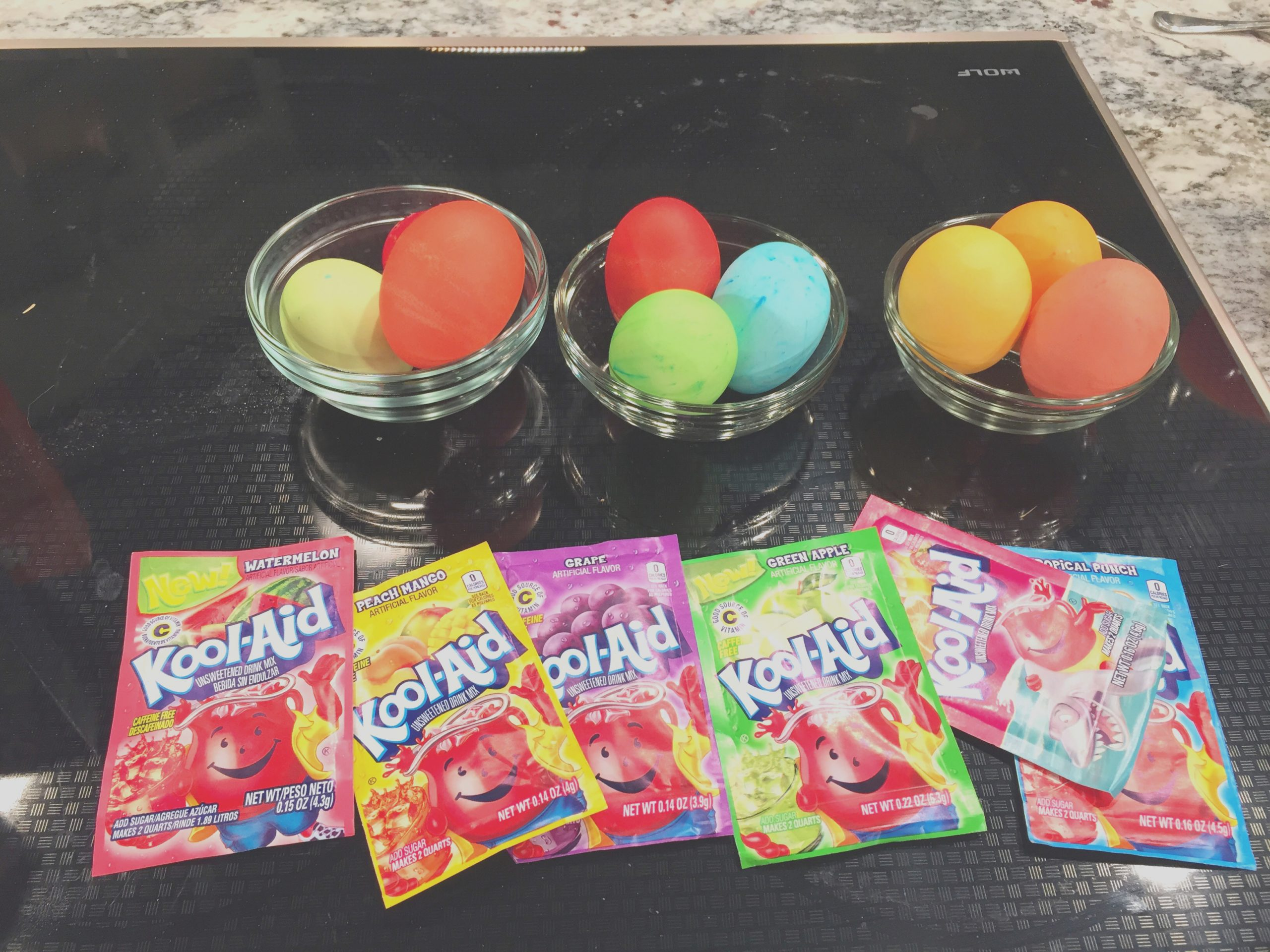 how to color easter eggs save money with kool aid plus easy instructions for the perfect hard boiled egg