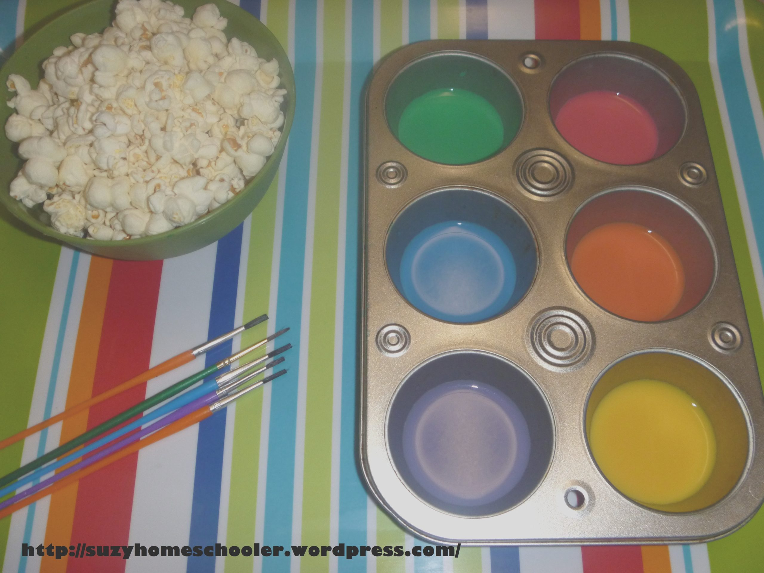 painting popcorn with edible paint aka milk and food coloring