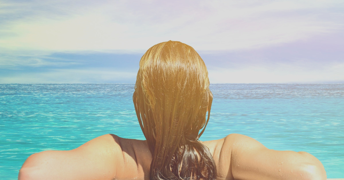 how to prevent your hair from turning green after swimming because it can put a damper