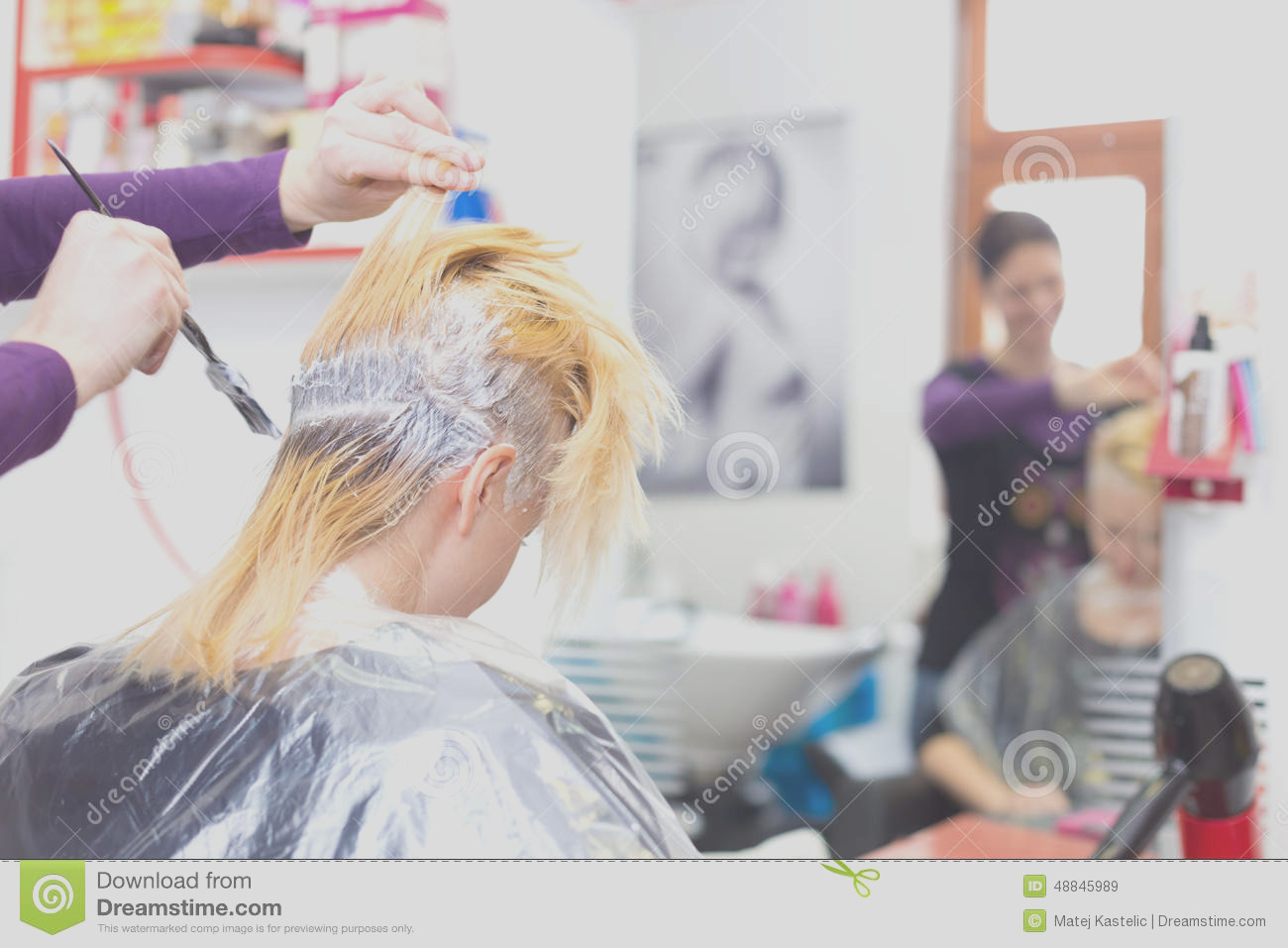 stock photo hairdresser salon woman hair dye colouring process beautiful young women dyeing hairs image